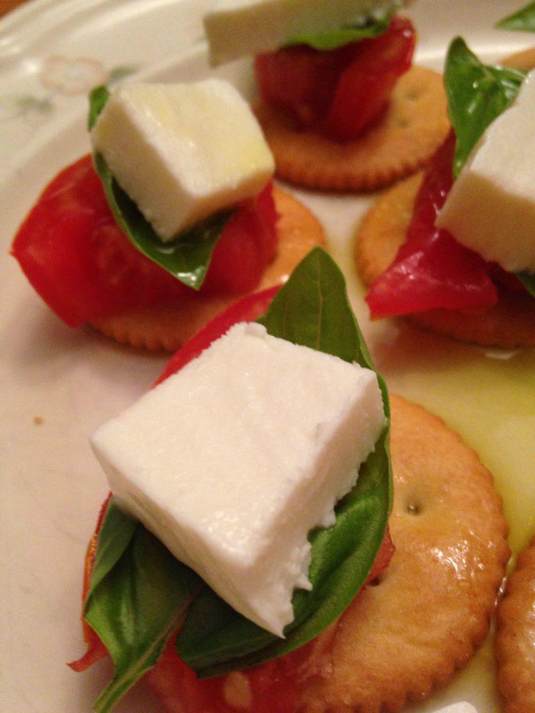 Fresh basil, fresh mozzarella, fresh tomato, Ritz cracker and olive oil stacks