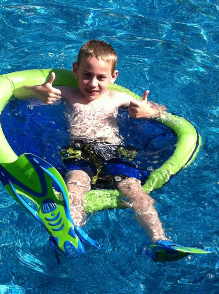 Kid in the pool with a floatie