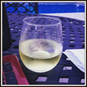 wine-and-computer-working-by-pool
