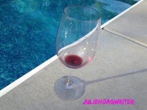 empty-wine-glass-by-pool-with-my-logo