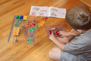 Boy playing with circuit toy