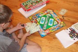 Child playing Allowance board game
