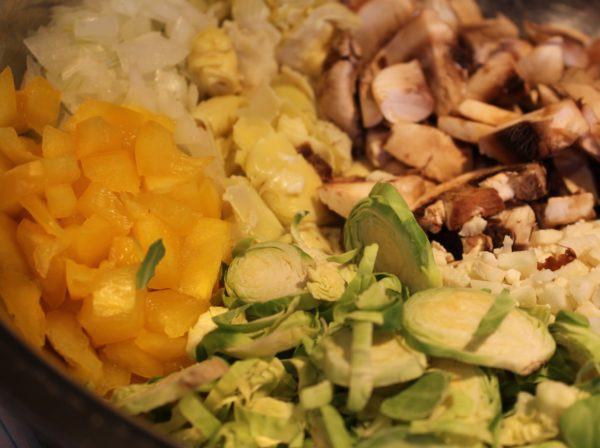Cut vegetables and combine in a bowl for Veggie Bean Alfredo Casserole