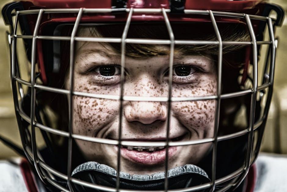 Smilling boy in a football helmet