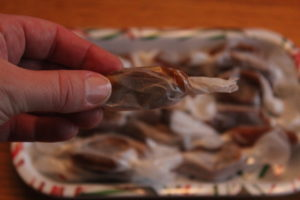 Old-Fashioned Christmas Caramels wrapped in wax paper squares