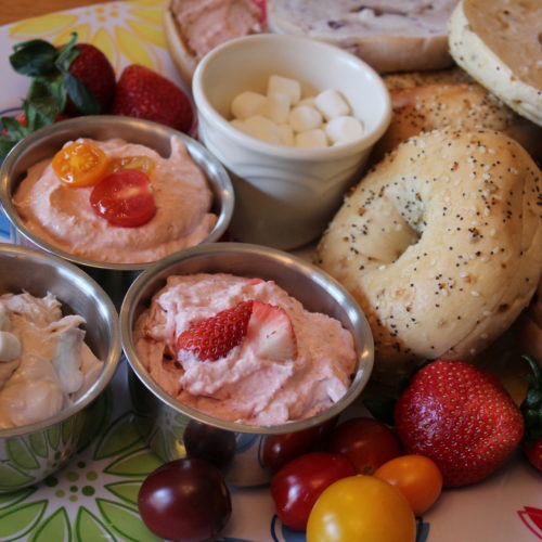 Flavored Cream Cheese Bagel Bar platter with Hot Chocolate, Apple Strawberry, and Tomato chili cream cheeses.