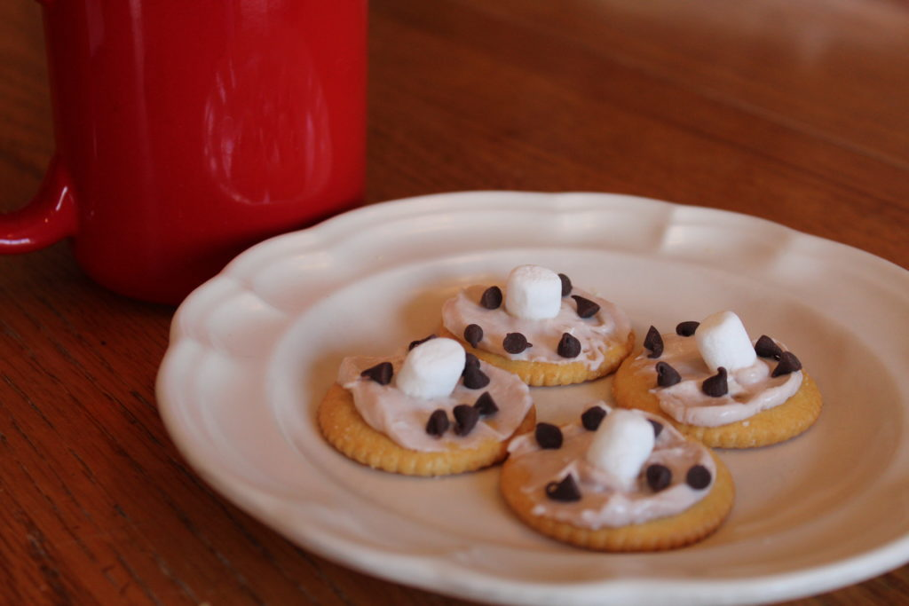 Spread the Whipped Hot Chocolate Cream Cheese on Ritz crackers and add a small marshmellow and mini chocolate chips.