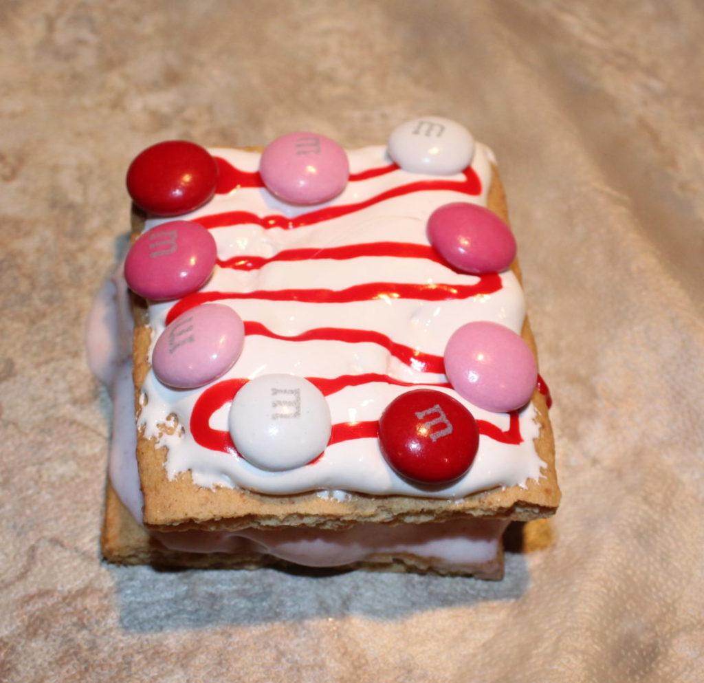 Super easy recipe, even kids could make this, for DIY Valentine's Ice Cream Sandwiches #valentinesday #icecreamsandwiches #treats #sweets #sweet #sweettreats #dessert #desserrecipes #homemade #diyfood #strawberry