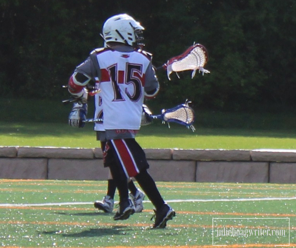 Child Playing Lacrosse