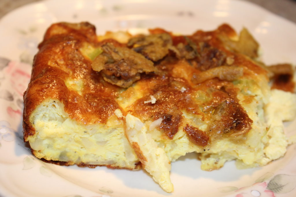 Side view of piece of Spicy Potato Egg Salad Bake