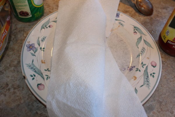 Place a white napkin or paper towel over the roll before microwaving.