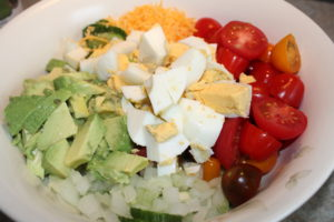 Vegetables and eggs diced for Veggie Avocado Egg Salad.
