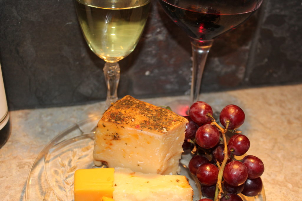 St. Urho's Day and Wine Club Review. Chardonnay and Zinfandel with red grapes, Mediterranean parmesan cheese, Wisconsin cheddar cheese. Delicious!