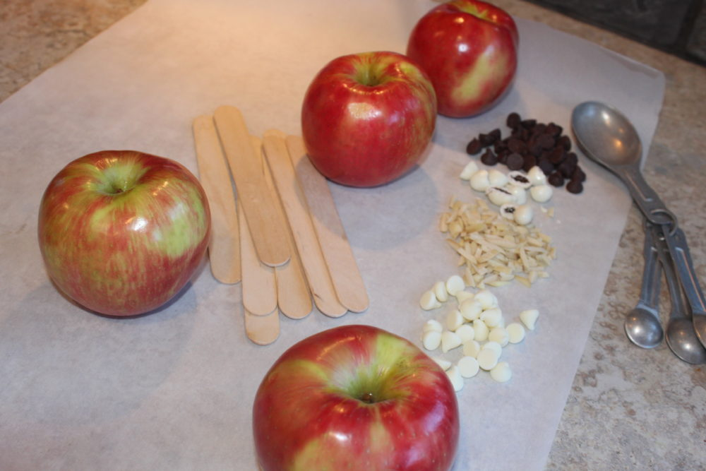 Apples, sticks, face ingredients to make Peanut butter butterscotched apple bunnies for Easter or spring treats.