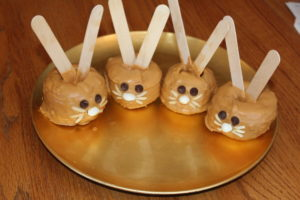 Four apple bunnies on a serving plate.