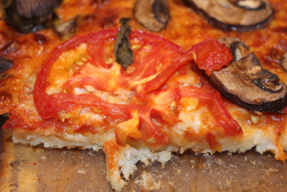 Hidden Cauliflower Crust Margherita Pizza recipe is a delicious vegetarian pizza. Added hidden veggies are inside the crust which adds more fiber and healthy cauliflower to this pizza. #cauliflower #lowcarbdiet #diet #pizza #vegetarianrecipes #vegetables #veggies #tomatoes #mushrooms #meatless #meatlessmonday #meatfreemonday #dinnertime #dinnerrecipes #cheese #recipeideas #lowcalorie #juliehoagwriter