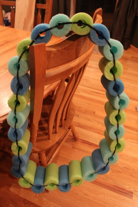 DIY Pool Noodle Float Ring made from pieces of pool noodle.