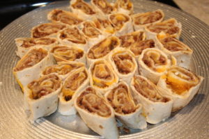 Platter of Pecan Squash Rolls. An easy tasty appetizer that tastes like a treat. Simple and easy to make.