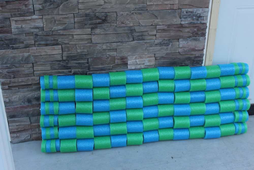 DIY Pool Noodle Float Raft made with segments of pool noodles. Fun for swimming for kids and adult. Family fun. Make your own design using new noodles or pieces of intact old noodles.