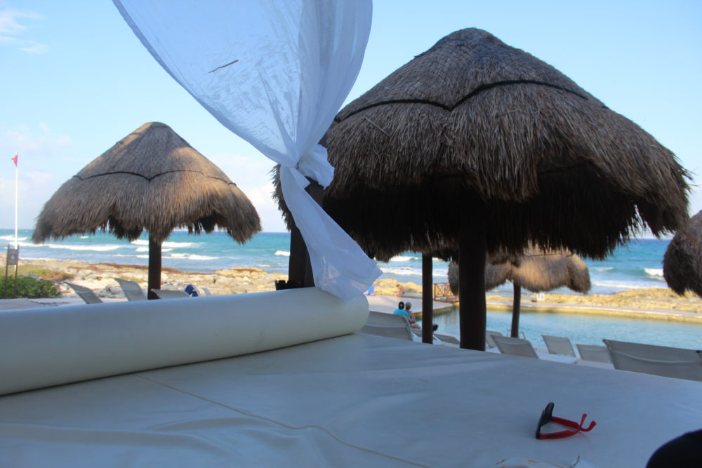 Lounging the way a Mom loves! A bed by the ocean, beverage, and ocean waves. Palladium all-inclusive resort Riviera Maya, Mexico. Family Travel.