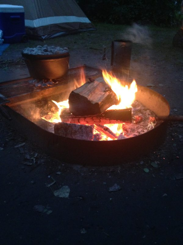 Dutch oven on bonfire pit for Onion Soup mix potatoes...so YUM! 20 things make family camping easier
