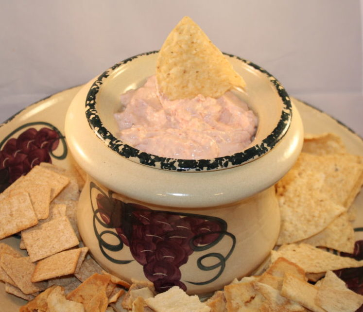 Dip with plate of chips and bagel chips