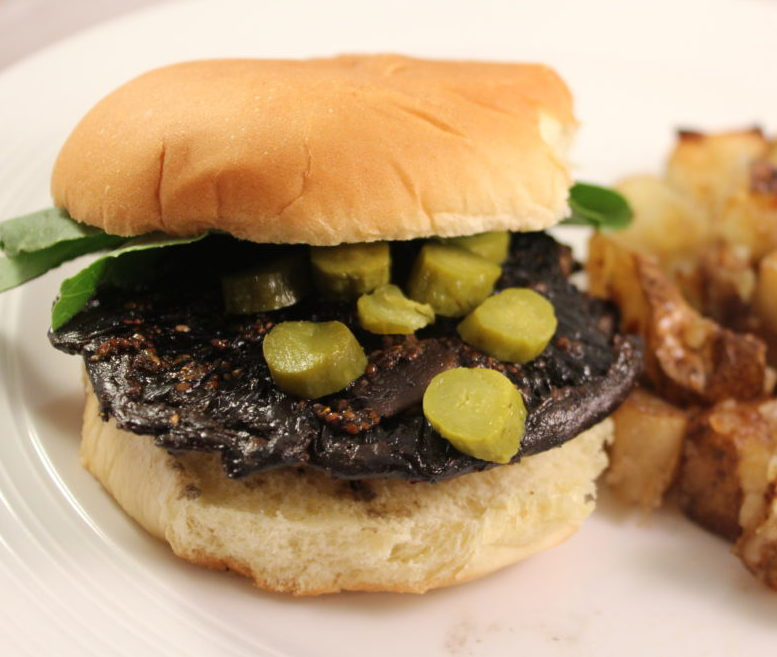 Marinated Balsamic Mushroom Cap Burger on a bun with potatoes