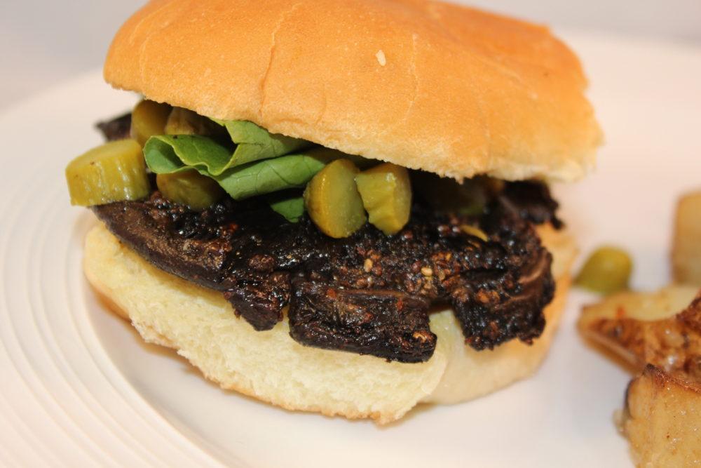Marinated Balsamic Mushroom Cap Burger on a bun with side of potatoes