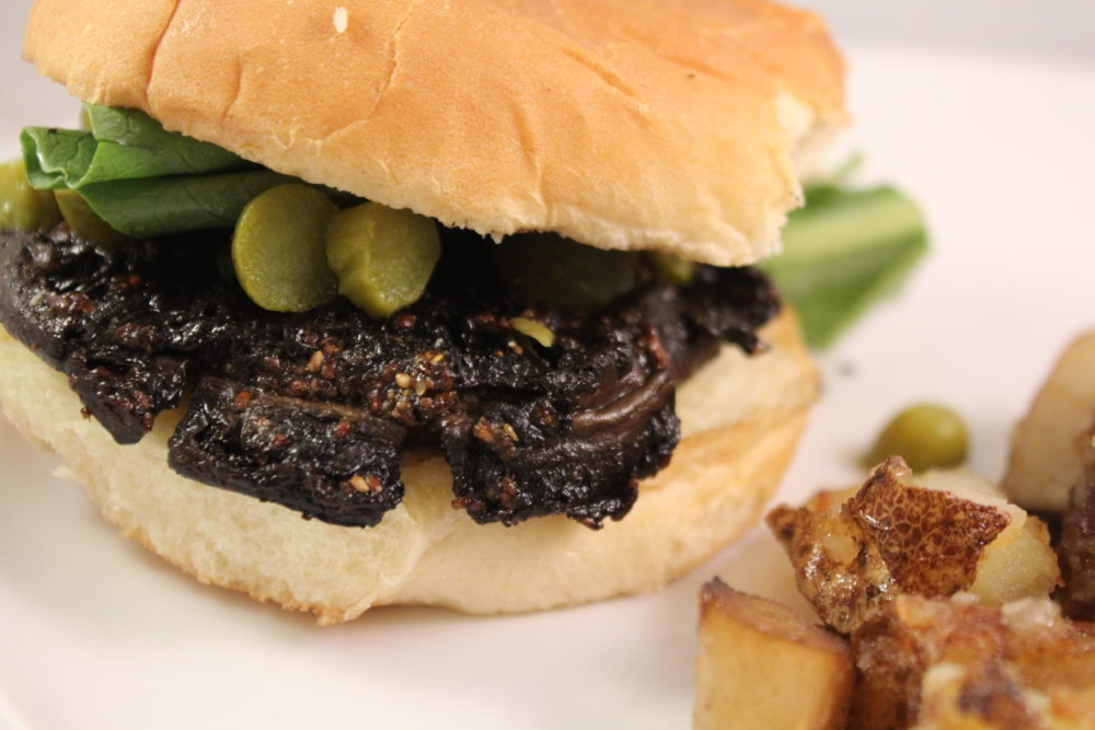 Amazing Marinating Secret Plus Marinated Balsamic Mushroom Cap Burger Recipe. Marinate mushrooms for a tasty grilled vegetarian and vegan mushroom cap burger. This recipe is paleo too. Grilling recipe for summer or any time of year. #vegetarianrecipes #veganrecipes #veganfood #grilling #mushroom #marinade #meatless #meatlessmonday #meatlessmondaynight #meatfreemonday #chiaseed #easyrecipe #vegetarianburger #meatlessburger #summerrecipes #vegetarian #juliehoagwriter #foodblogger