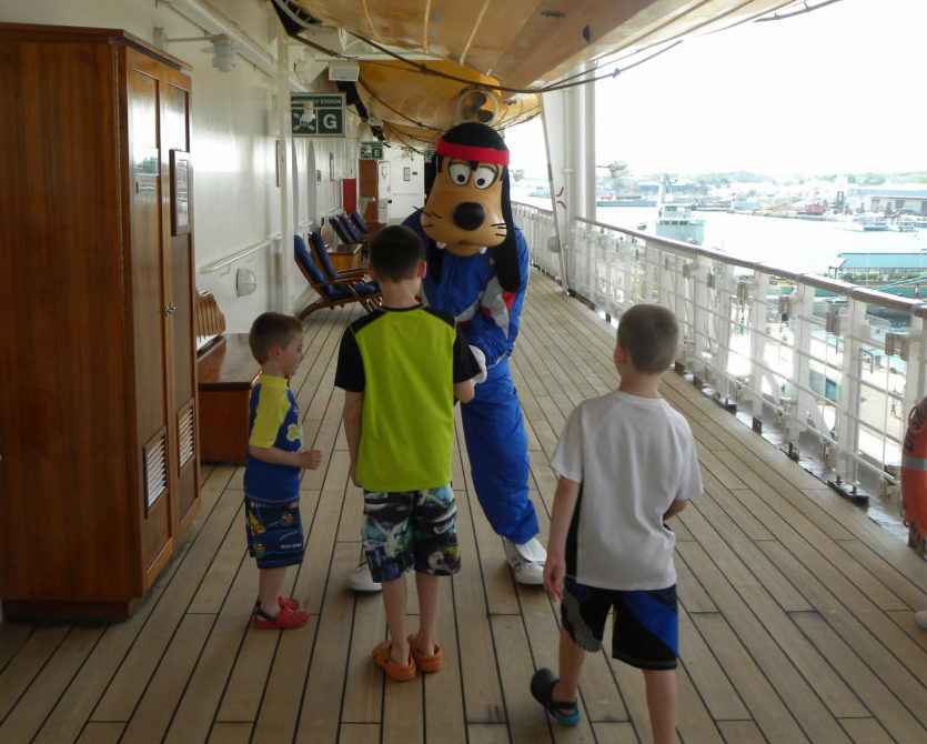 Meeting Goofy on cruise ship deck for an autograph and pictures.