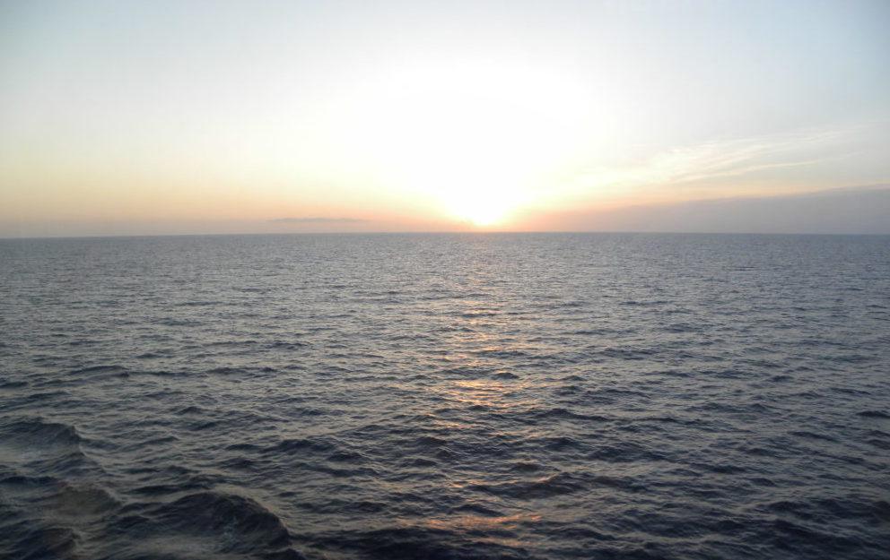 Open sea sun starting to set