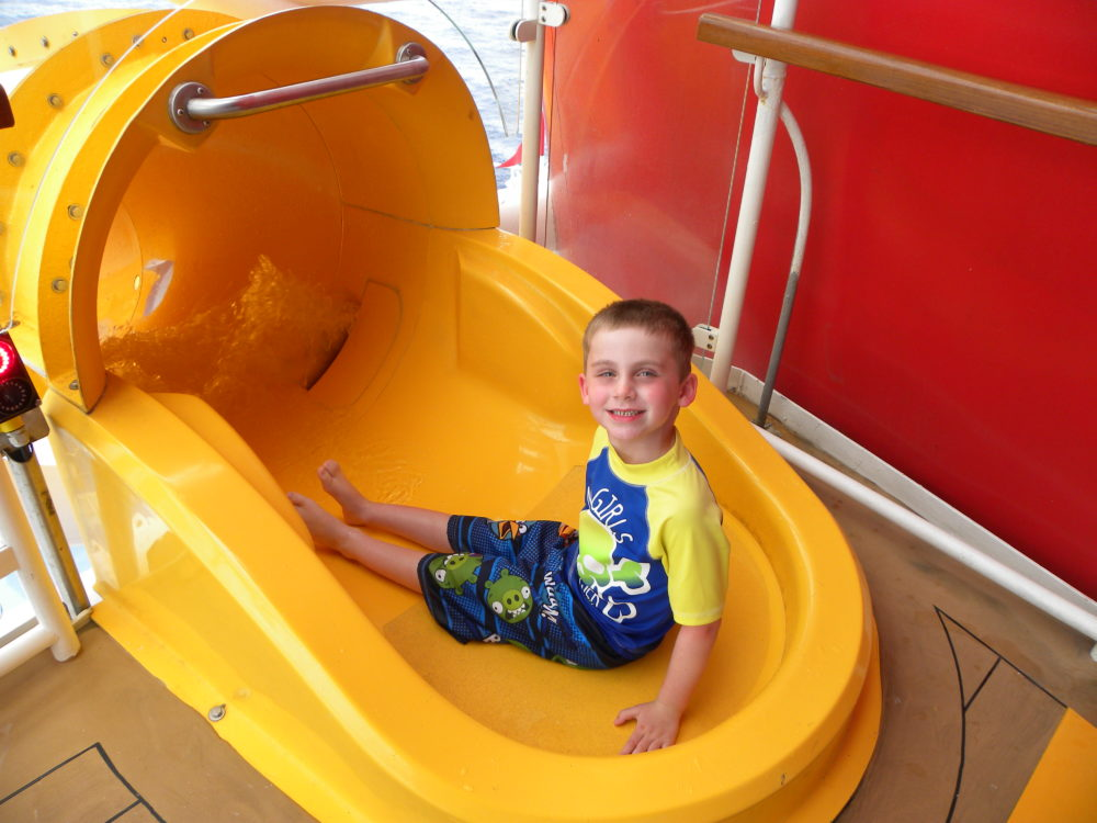 Ready to go down yellow kid-friendly slide