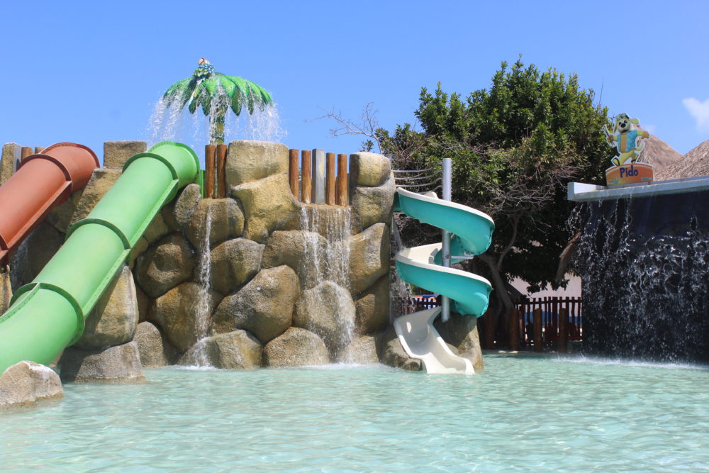 Kiddie pool slides at large all-inclusive resort.