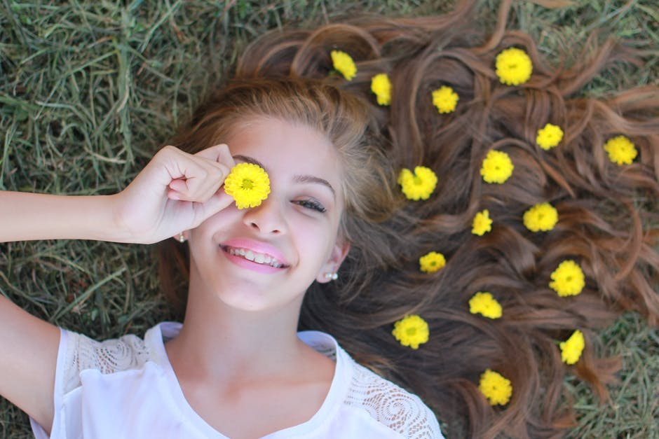young tween girl with flowers smiling