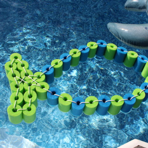 DIY Pool Noodle Fish Float With Headrest in the pool. pool-float-diy-swimming-pool-toy-float