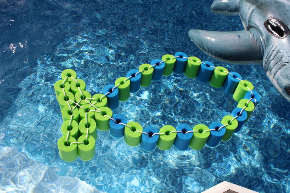 DIY Pool Noodle Fish Float With Headrest in the pool. pool float-diy-swimming pool toy-float-DIY Pool Noodle Fish Float With Headrest-pool noodle ideas-swimming pools-inground pool-noodle crafts-pool noodles-pool ideas-pool toys-pool toys for kids-pool floats-pool floats for adults-swimming pools-swimming pool ideas-swimming pool backyard-pool play-pool fun for kids-pool fun ideas-swim floats kids-swim floats summer. @juliehoagwriter.com