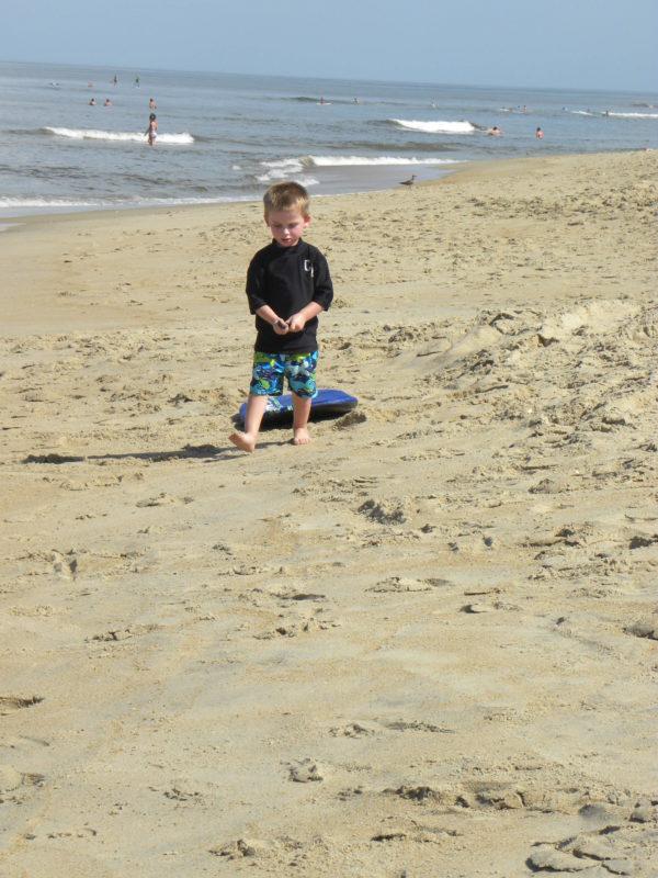 Dragging the board around the beach