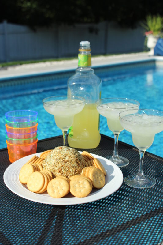Jalapeno Chia and Pumpkin Seed Cheese Ball on outdoor kitchen counter with margaritas. Pool party and grilling. Appetizer recipe for a crowd | vegetarian appetizer | healthy appetizer | easy appetizer recipe.