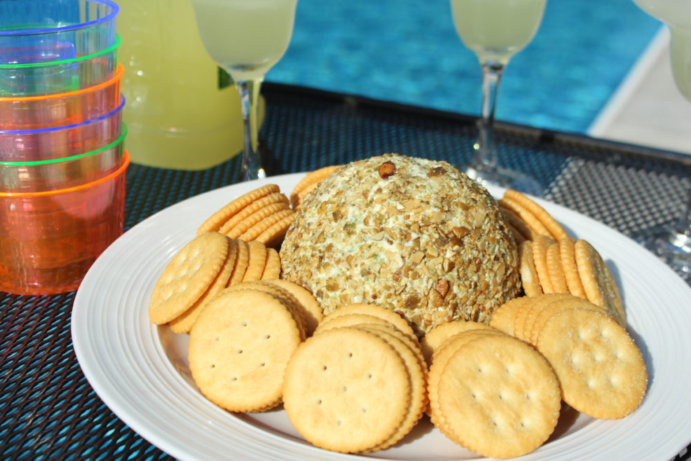 Jalapeno Chia and Pumpkin Seed Cheese Ball on outdoor kitchen counter with margaritas. Pool party and grilling. Appetizer recipe for a crowd | vegetarian appetizer | healthy appetizer