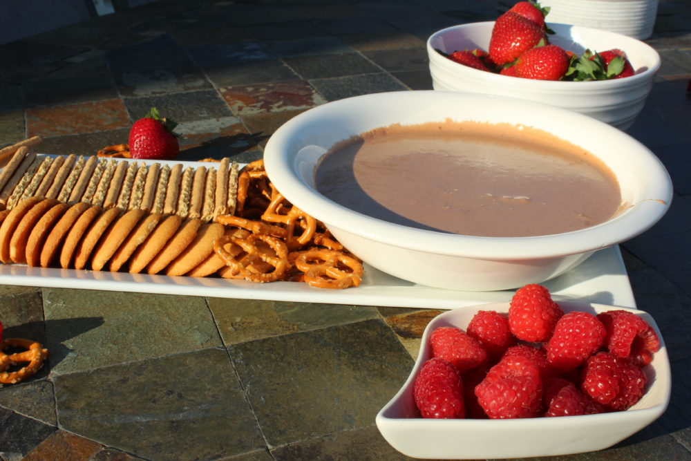 Nutella Smores Dip for a party with berries, crackers, Nilla Wafers and pretzels. Nutella Smores Dip on berries and Nilla wafer. Delicious recipe. Easy recipe for S'more Party Dip-fall food-fall food recipes-fall foods for a party-fall food ideas-fall foods for a party-party dessert-simple appetizer-simple dessert appetizer-potluck recipes-potluck dishes-kid friendly food @juliehoagwriter.com