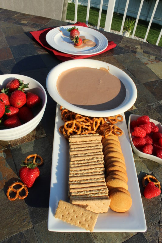 Nutella Smores Dip on berries and Nilla wafer. Delicious recipe. Easy recipe for S'more Party Dip-fall food-fall food recipes-fall foods for a party-fall food ideas-fall foods for a party-party dessert-simple appetizer-simple dessert appetizer-potluck recipes-potluck dishes-kid friendly food @juliehoagwriter.com