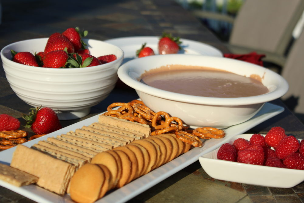 Nutella Smores Dip with fresh berries, graham crackers, Nilla Wafers, and pretzels. Yummy easy recipe. Simple recipe with four ingredients plus dippers. S'mores recipe. easy-appetizer-fall food ideas-appetizers for a crowd-fall foods for a party-potluck recipes-dessert recipe for a group-potluck ideas-party dessert ideas @juliehoagwriter.com