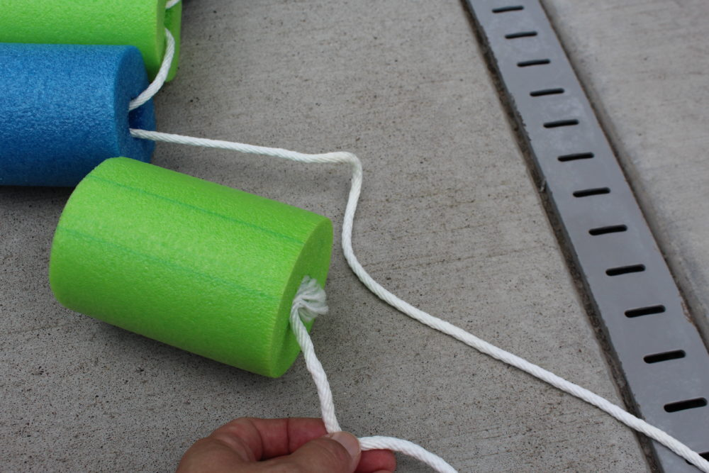 Making DIY Pool Noodle Fish with Headrest. feed both ends of the rope through the next pool noodle section and pull taut
