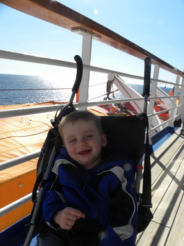 12 Cruise Tips for Travel with 3 young kids.The Fantasy, a Carnival Cruise ship. #cruisetips #carnivalcruisetips Traveling with kids-cruising with kids Carnival-cruising with kids tips #Familyfriendly bring an umbrella stroller