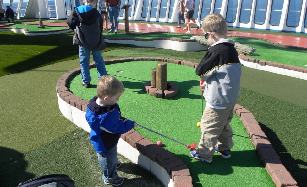 12 Cruise Tips for Travel with 3 young kids.The Fantasy, a Carnival Cruise ship. #cruisetips #carnivalcruisetips Traveling with kids-cruising with kids Carnival-cruising with kids tips | Mini golf course on the cruise ship