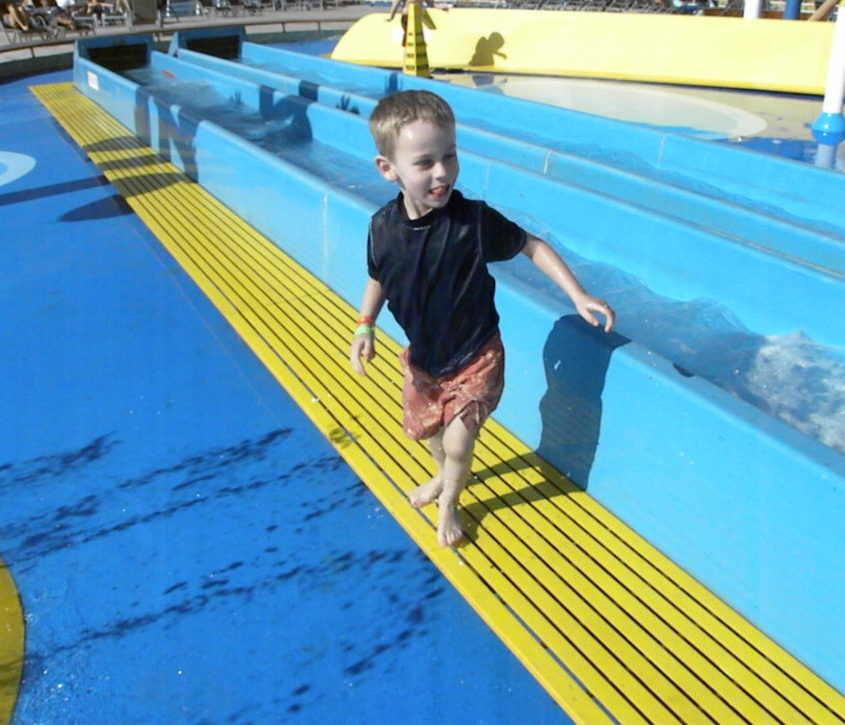 12 Cruise Tips for Travel with 3 young kids.The Fantasy, a Carnival Cruise ship. #cruisetips #carnivalcruisetips Traveling with kids-cruising with kids Carnival-cruising with kids tips #Familyfriendly water slides