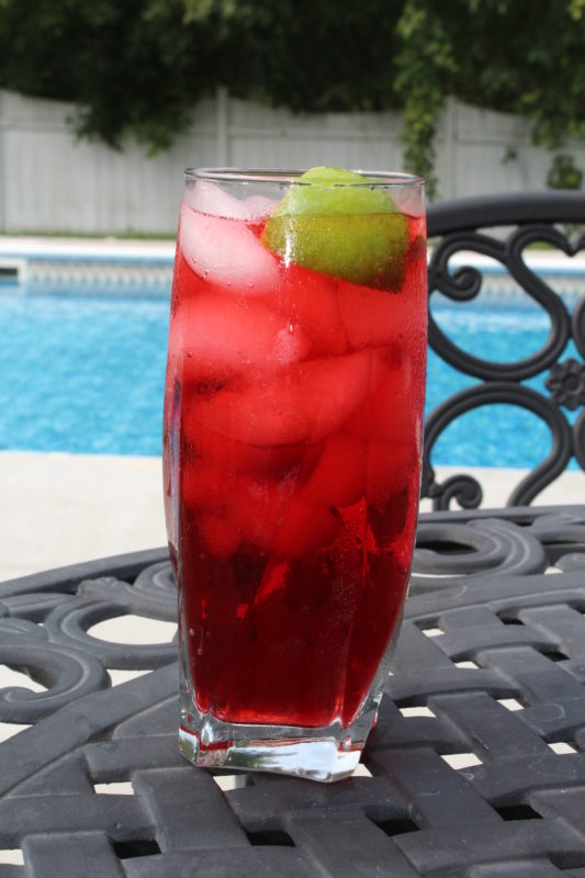 Adagio Teas Wild Strawberry Iced tea with lime by the pool