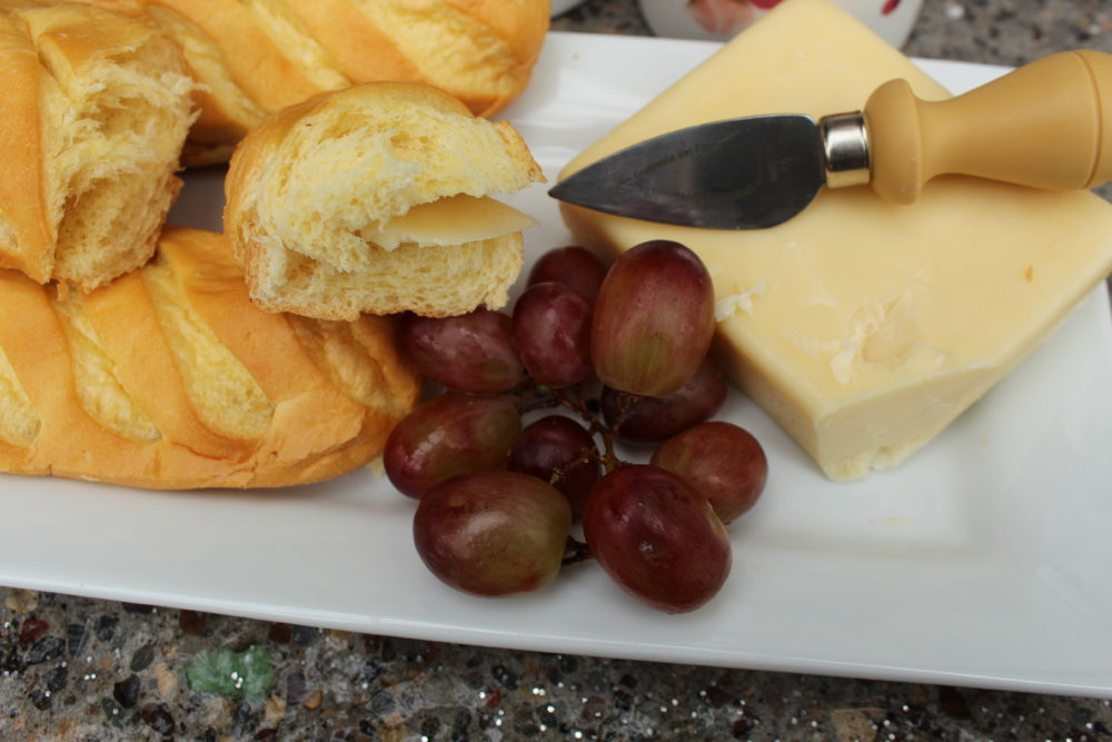 Soft brioche baguette with cheese and grapes on a platter. #tastybread #briochebread #healhtysnack #appetizersforaparty