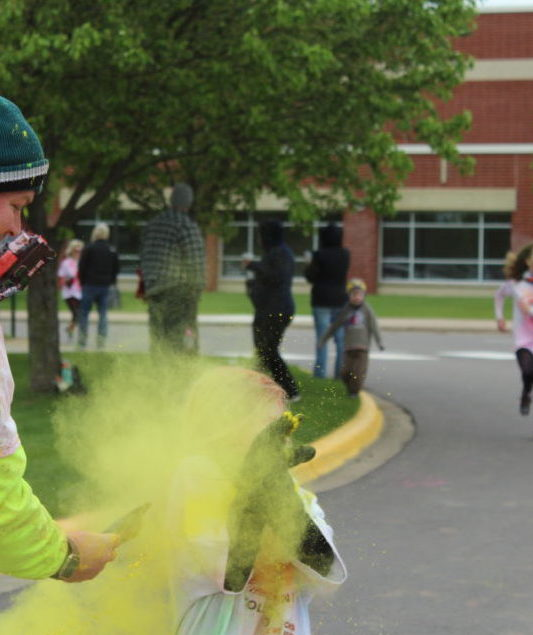 Color Run finish line runner blasted with yellow powder