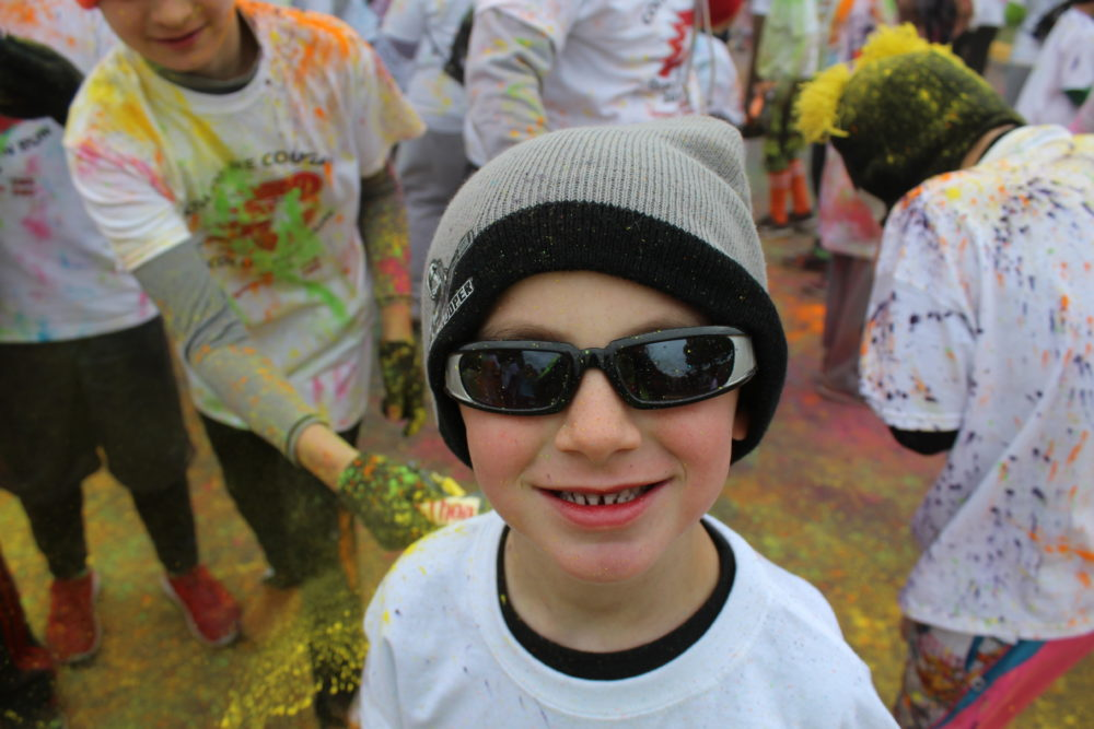 Color Run participant raising money for a charity while exercising with the fun of color added in. #exercisingwithfamily #familyfun #colorrun #familytime #family